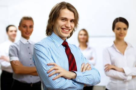 Young smiling happy businessman at work in office Stock Photo - 12404283