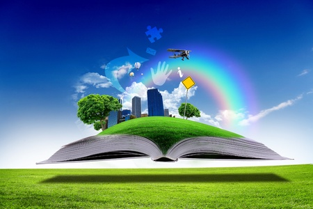 Open book with green nature world coming out of its pages photo