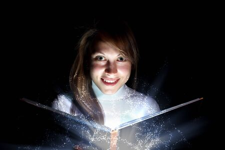 Collage of a young woman reading a magic book photo