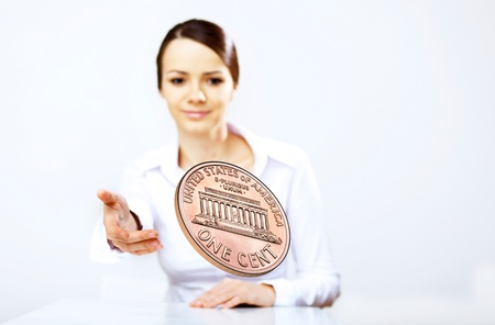 Person throwing a coin as symbol of risk and luck Stock Photo - 12404422