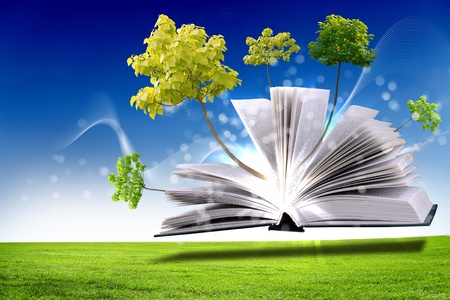 knowledge concept: Open book with green nature world coming out of its pages