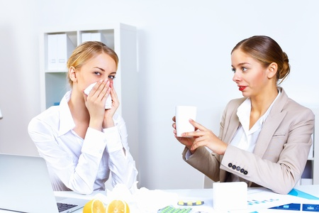 Young woman feeling unwell and sick in office Stock Photo - 12404411