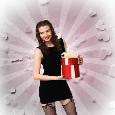Young pretty woman in black dress with a gift box Stock Photo - 12404526