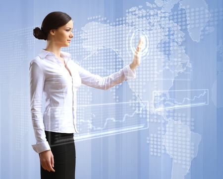 touch screen hand: Young woman in business wear with touchscreen technology background