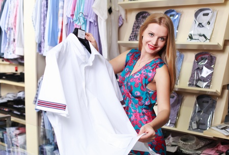 2 50: Young beautiful girl in a clothing store salesman