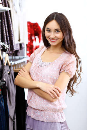 Portrait of young woman inside a store buying clothes Stock Photo - 12561638