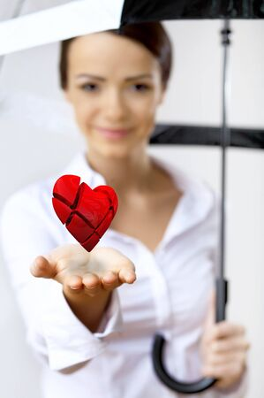 Young woman with a red heart in her hand Stock Photo - 12561555