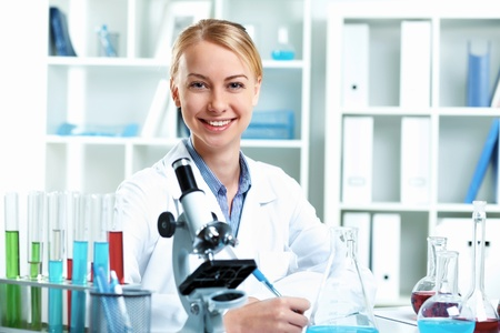 medical scientist: Young scientist in white uniform working in laboratory Stock Photo
