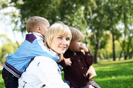 Young mother with her little son in summer park photo
