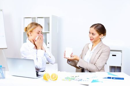 Young woman feeling unwell and sick in office Stock Photo - 12561414