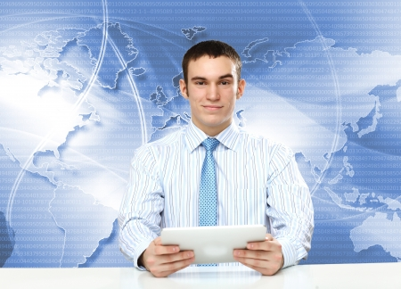 Portrait of a young businessman making presentation photo