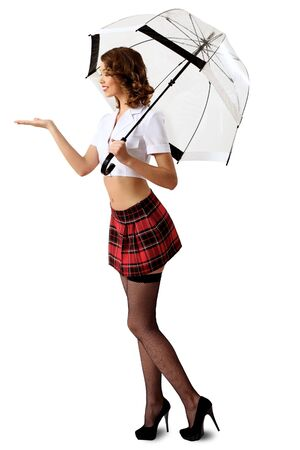 Young prestty woman dressed in retro style with umbrella Stock Photo - 12561290