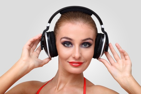 Portrait of young woman in evening dress with headphones Stock Photo - 12561125
