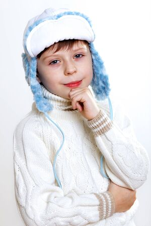 Portrait of little kid in winter wear against white background Stock Photo - 12561063