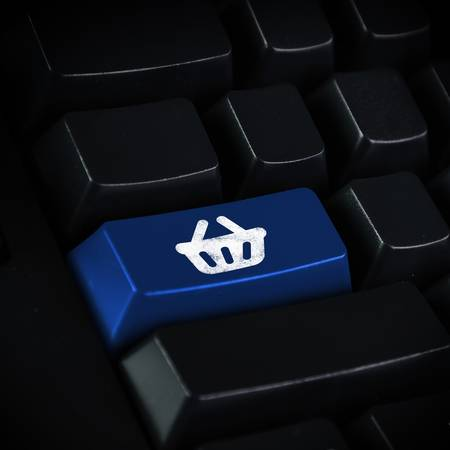 Computer keyboard with on-line shopping symbol on it photo