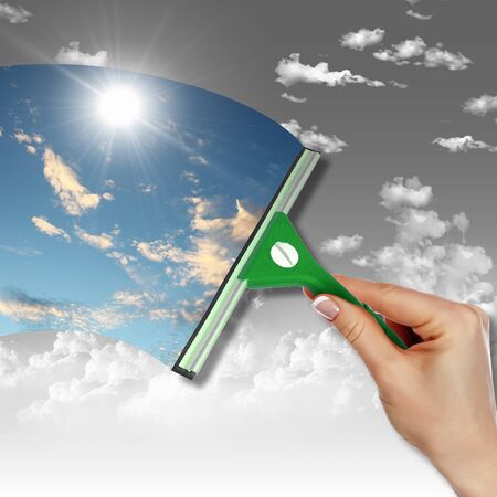 Hand cleaning window with blue sky and white clouds Stock Photo - 12739288