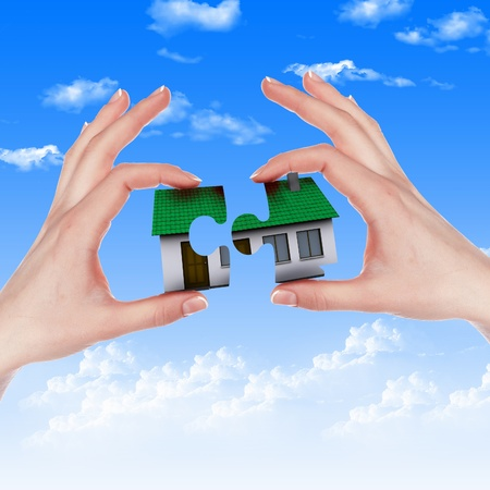 mortgage: Human hand against blue sky background and house Stock Photo