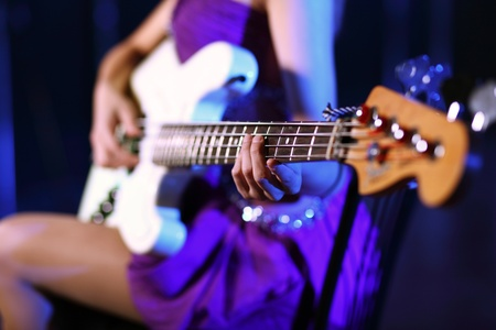 Young guitar player with instrument performing in night club Stock Photo - 12739087