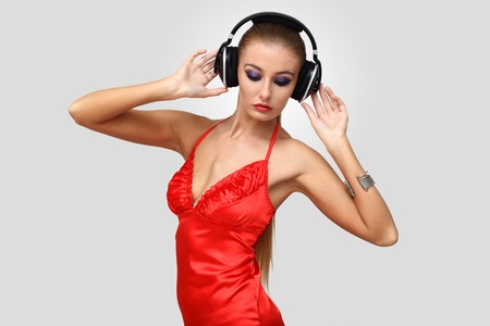 Portrait of young woman in evening dress with headphones Stock Photo - 12739104