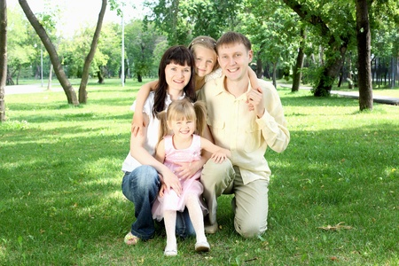 Parents with children together in the park photo