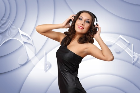 Portrait of young woman in evening dress with headphones Stock Photo - 12804421