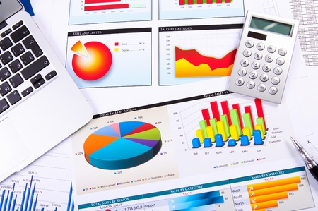 account management: Graphs, charts, business table  The workplace of business people