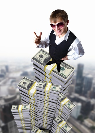 Young businessman in sun glasses with money photo