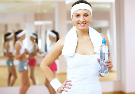 aerobic exercise: Young woman in sport wear doing sport in gym