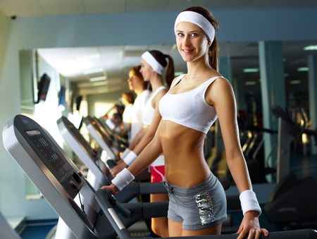 Young woman in sport wear doing sport in gym photo