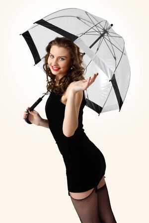 Young prestty woman dressed in retro style with umbrella photo