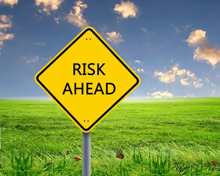 Picture of yellow road sign warning about risk ahead Stock Photo - 12923729