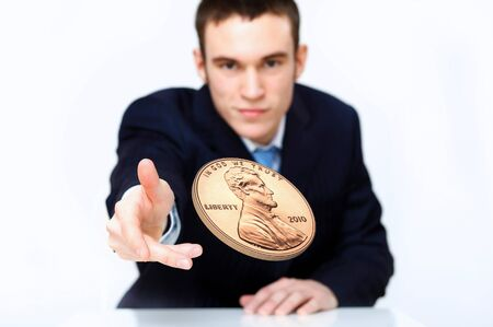 Person throwing a coin as symbol of risk and luck photo