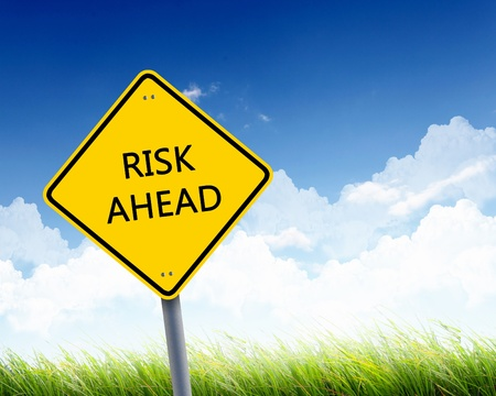 Picture of yellow road sign warning about risk ahead Stock Photo - 12923761