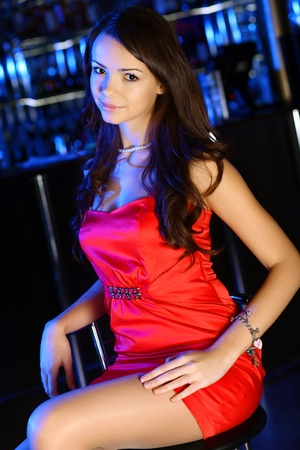 Portrait of young attractive woman in night club with a drink Stock Photo - 12923749