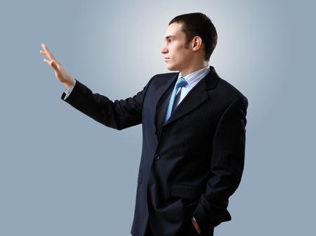 Portrait of a man in business wear making presentation