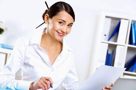Portrait of young woman in business wear in office Stock Photo - 12994669