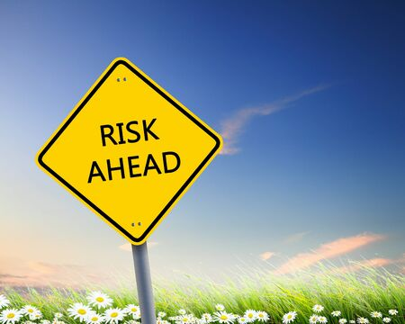 Picture of yellow road sign warning about risk ahead Stock Photo - 12996339