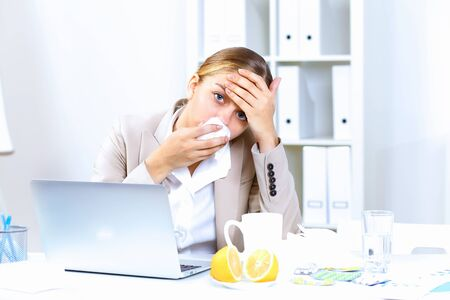 Young woman feeling unwell and sick in office Stock Photo - 12992867