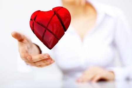 Young woman with a red heart in her hand photo