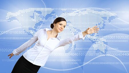 Young woman in business wear with touchscreen technology background photo