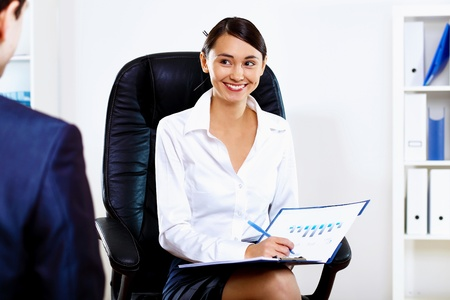 Portrait of young woman in business wear in office photo