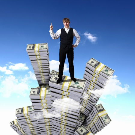 money making: Young businessman with money symbols against blue skyy background