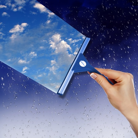 Hand cleaning window with blue sky and white clouds Stock Photo - 13197024