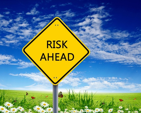 Picture of yellow road sign warning about risk ahead Stock Photo - 13197155