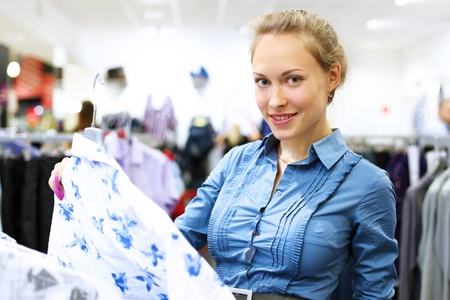 Young woman in a shop buying clothes Stock Photo - 13197003