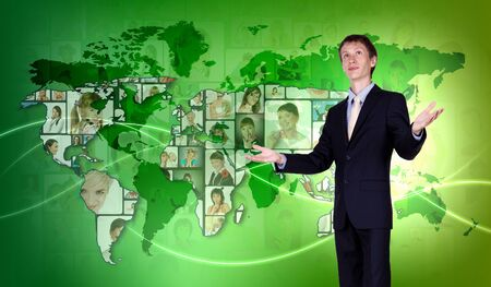 Young man standing against world map background photo