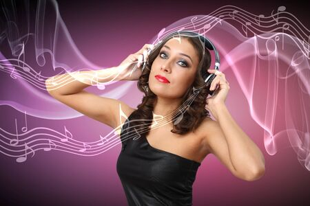 Portrait of young woman in evening dress with headphones photo