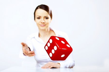 Image of a flying dice as symbol of risk and luck photo