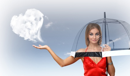 Pretty young woman with umbrella and with hearts on the background photo