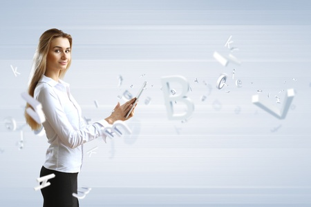 Young woman in business wear with touchscreen technology background Stock Photo - 13171593